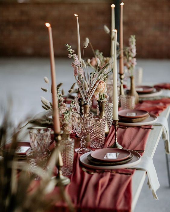 the-earthen-cutlery-with-glass-and-candles-on-the-table-top