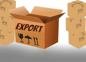 A cardboard box with the word export written on it and a lot of cardboard boxes in the background.