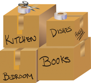 Four cardboard boxes with names of rooms written all over - one of the ways you can help your child move out