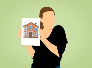 Graphic - A faceless woman holds a drawing of a house