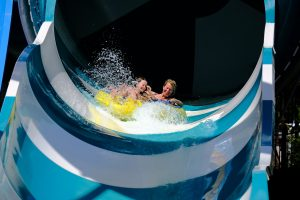 A couple going down a slide in one of the water parks in Long Island.
