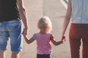 Parents and a child holding hands