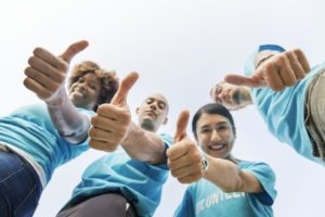 A group of people showing thumbs up because they know hiring movers is inevitable to organize your business relocation properly.