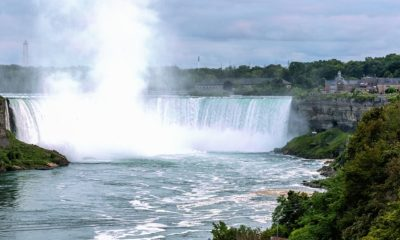 A view of Niagara Falls with water rising up in the once it crashes downs the fall slides.